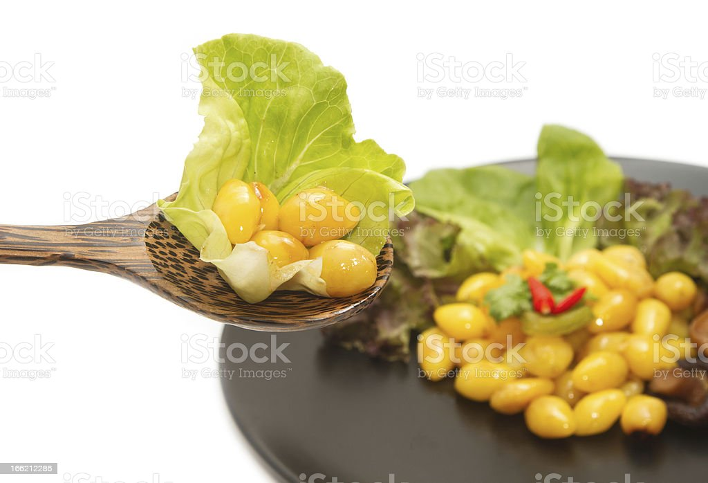 Wooden spoon with ginkgo seed,vegeterian food royalty-free stock photo
