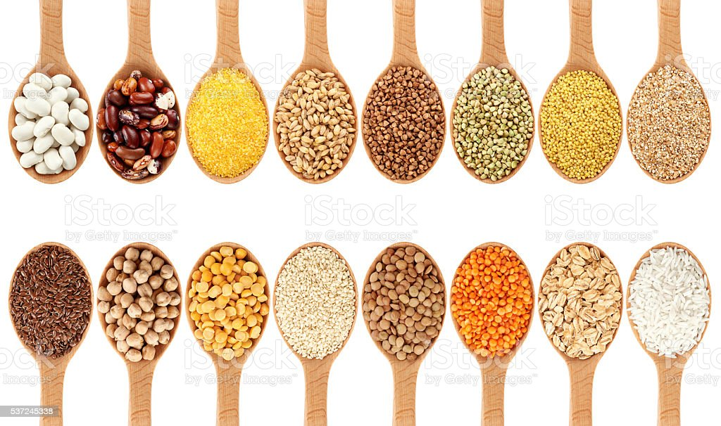 Wooden spoon with porridge, cereals, lentils, peas and beans. stock photo