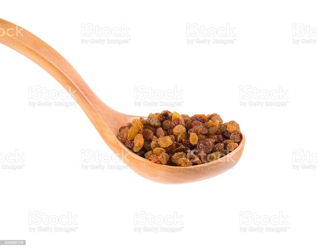 Wooden spoon with raisins. stock photo