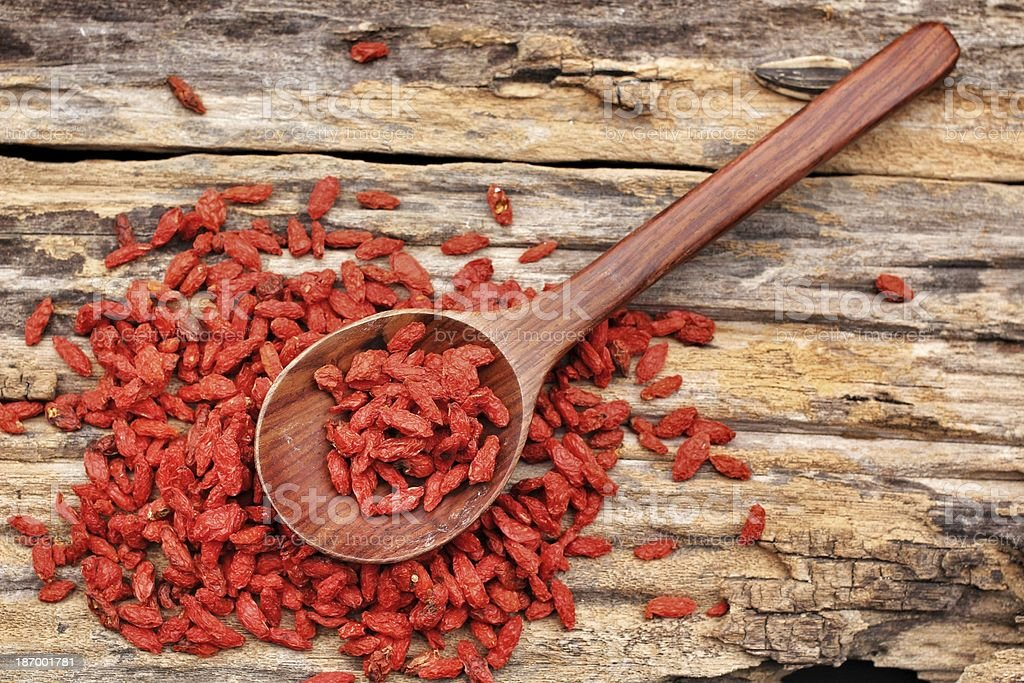 A wooden spoon with red, dried goji berries royalty-free stock photo