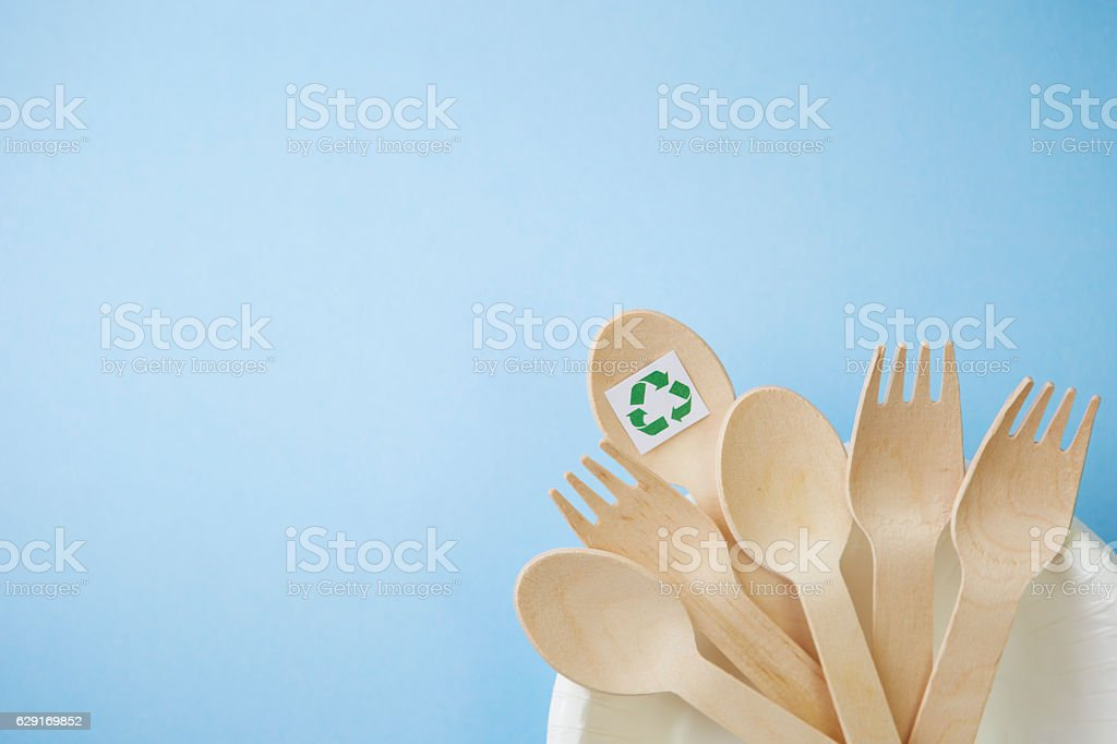 Wooden spoons and forks with recycle symbol stock photo