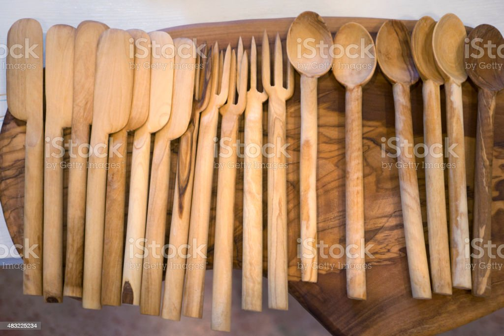 Wooden spoons, forks, paddles stock photo