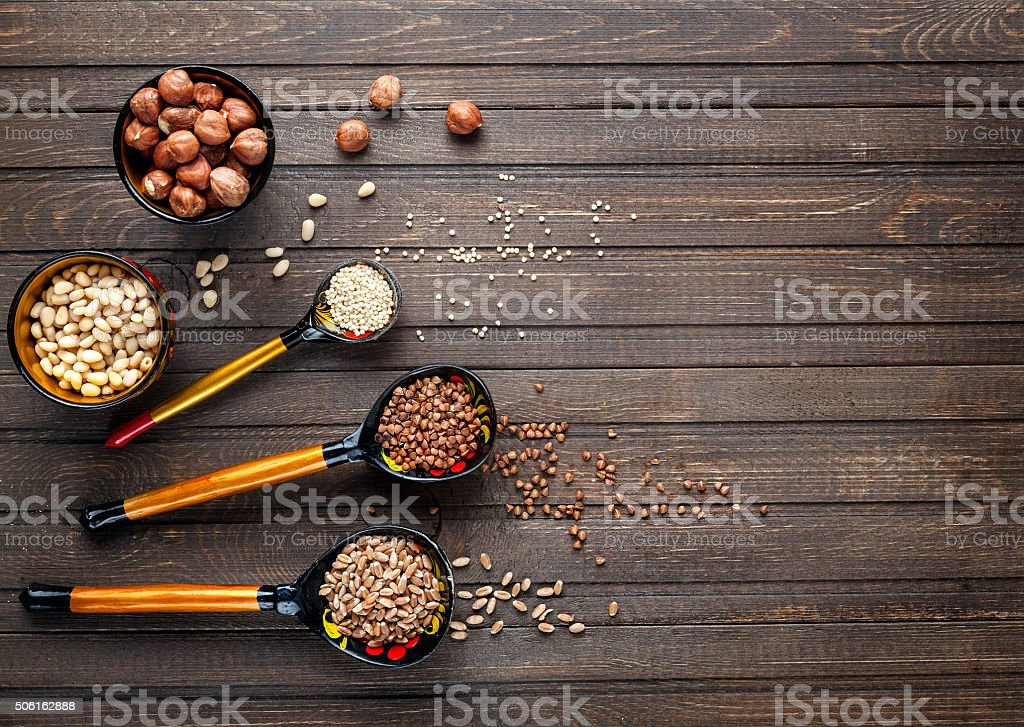 Wooden spoons painted with Khokhloma whith cereal stock photo
