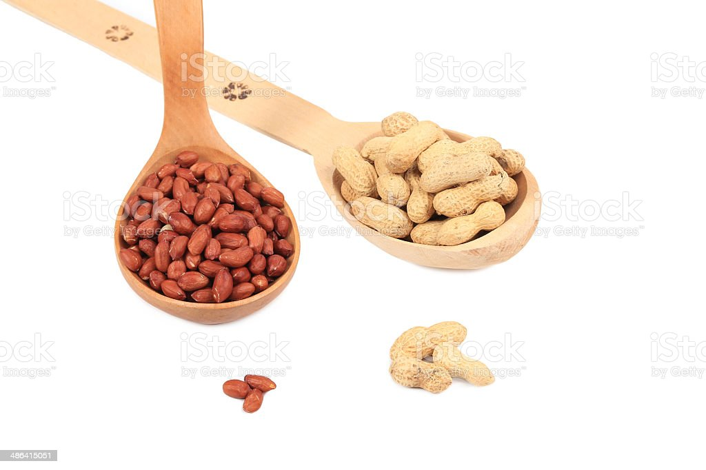 Wooden spoons with peanuts. royalty-free stock photo