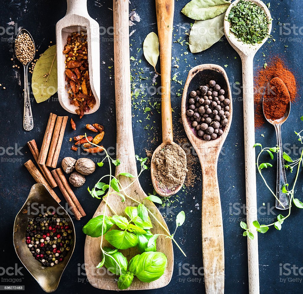wooden spoons with spices and herbs stock photo
