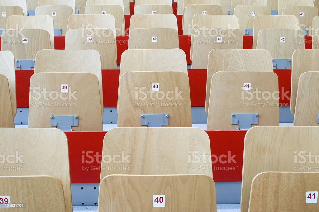 Wooden stadium seats with red numbers on each. royalty-free stock photo