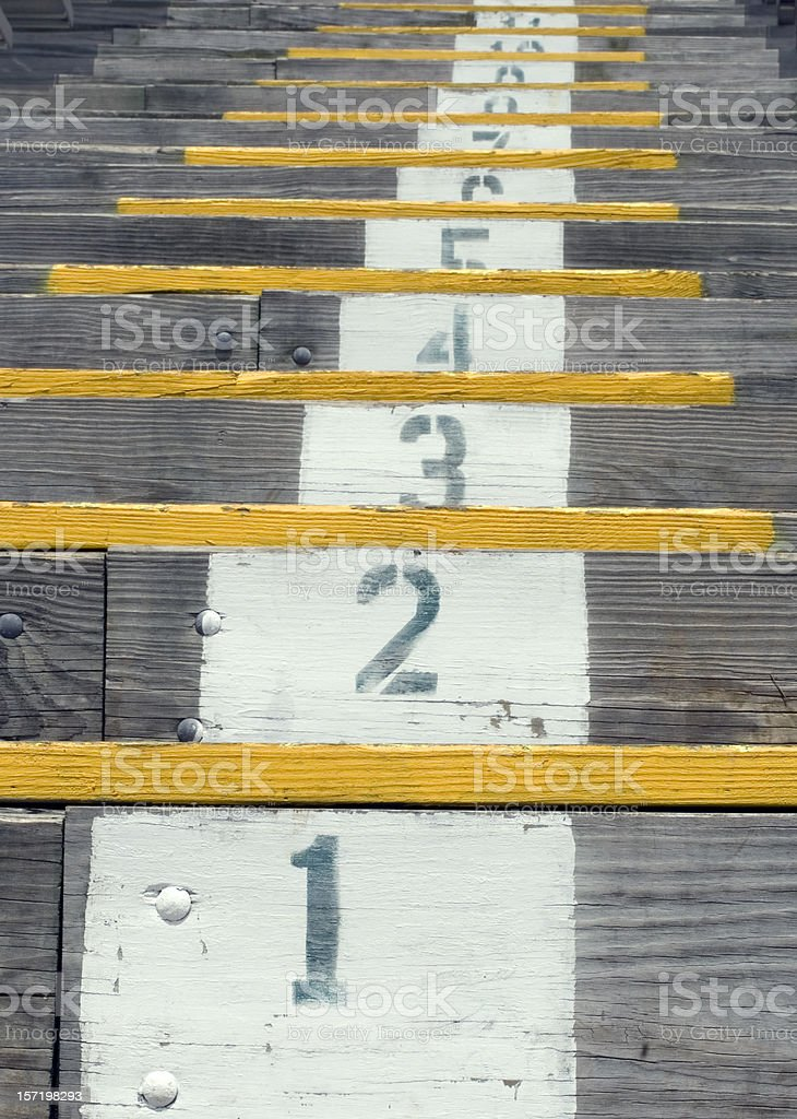 Wooden stadium steps royalty-free stock photo