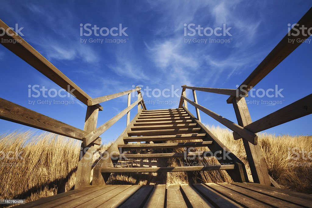 Wooden Stair in the Sky ( Sylt - Germany ) stock photo