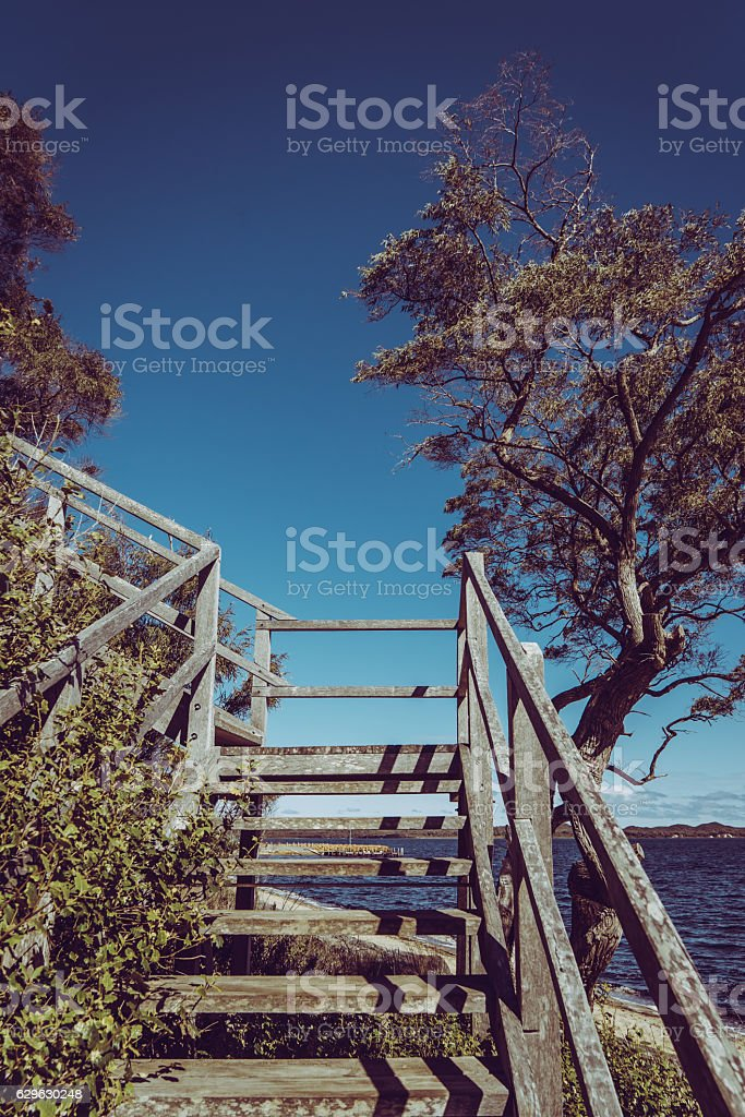 Wooden stair with scene view on Coalmine Beach stock photo
