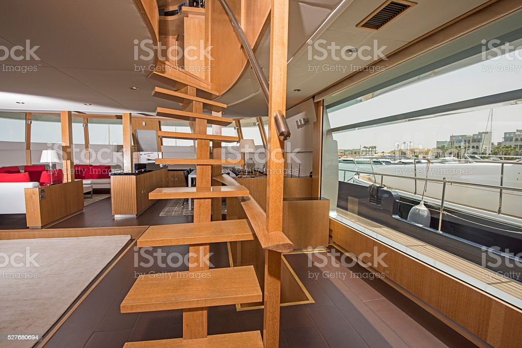 Wooden staircase in salon of luxury yacht stock photo
