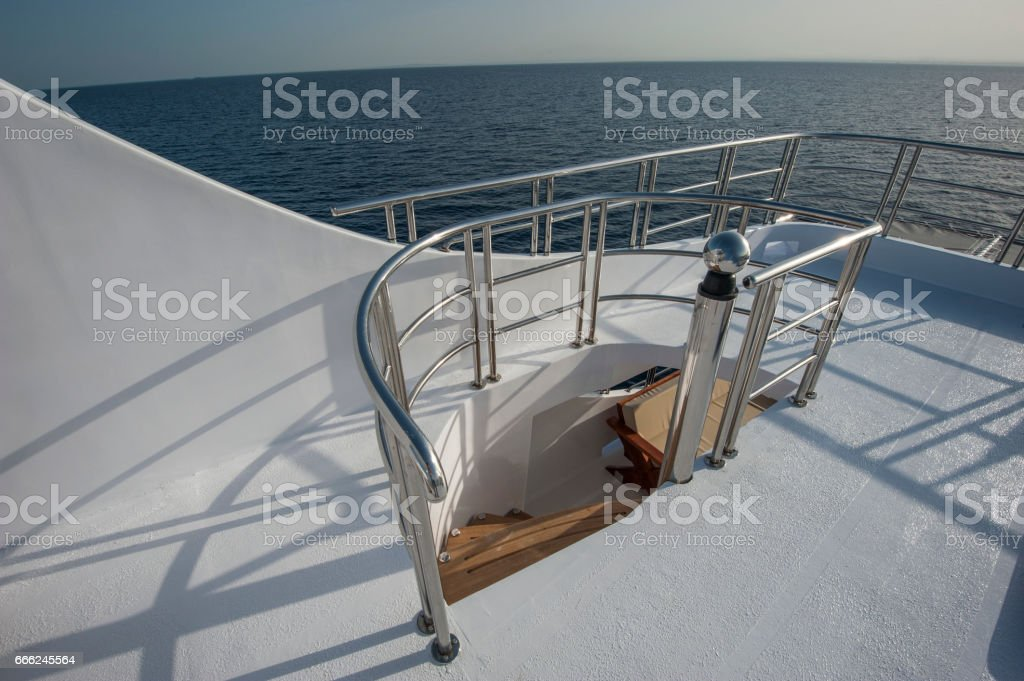 Wooden staircase on sundeck of luxury yacht stock photo