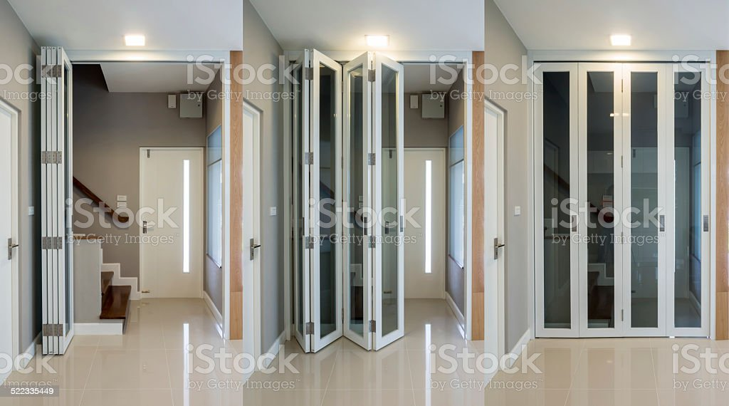 Wooden staircase with folding doors stock photo