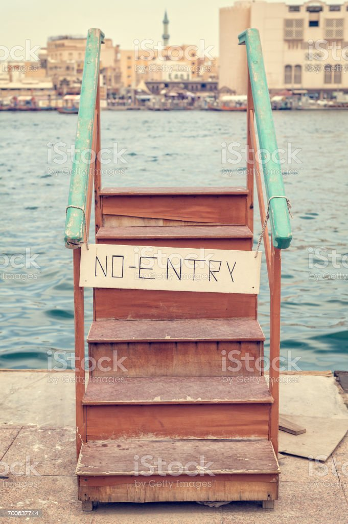 Wooden staircase with no entry sign. Conceptual image. stock photo