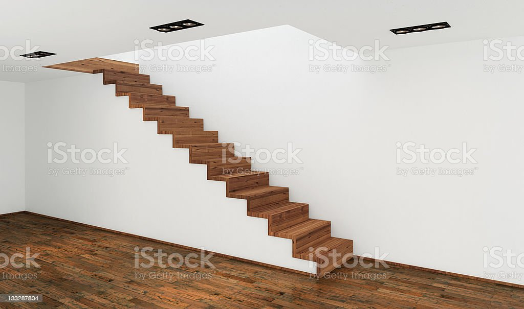 Wooden stairs against wall in a stark modern white house stock photo