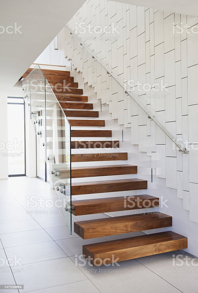 Wooden stairs in modern house stock photo