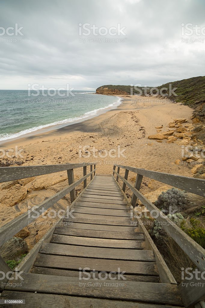 Wooden stairs leading down to Bells Beach, State of Victoria stock photo