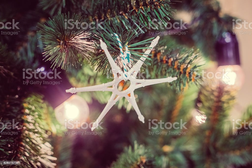 Wooden star as x'mas decoration. Garland in the form stock photo