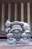 Wooden statue of Ebisu, Japanese god of luck.