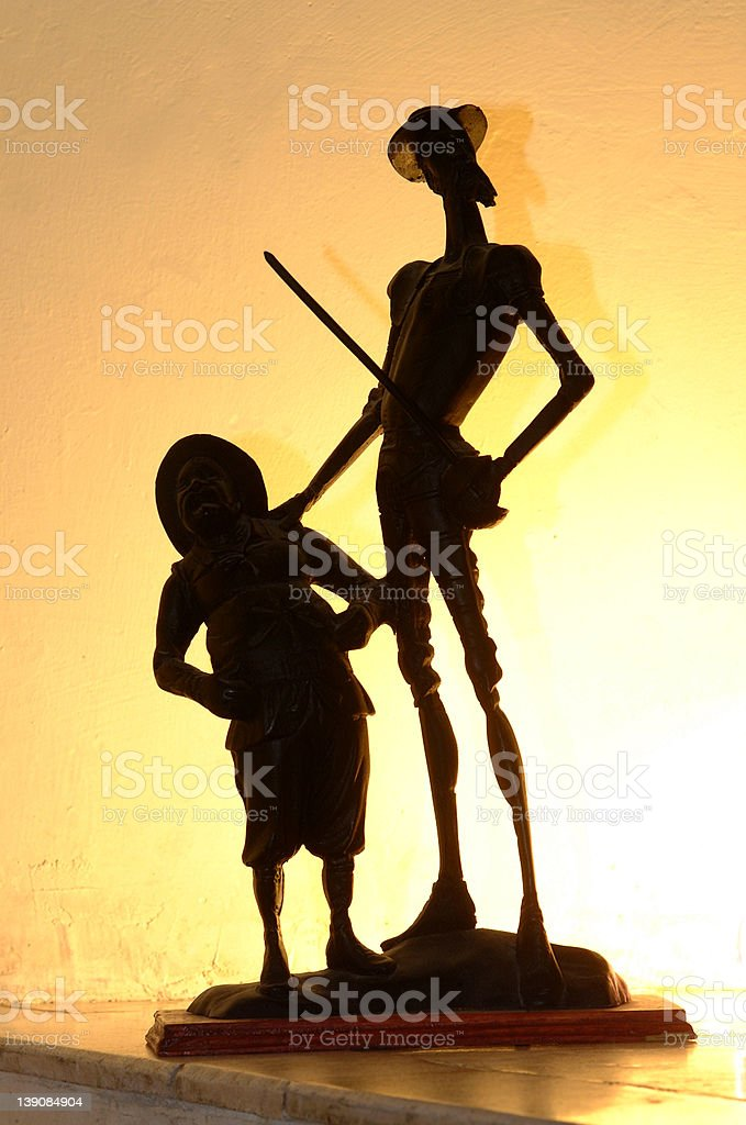 Wooden statue of knight and shieldman in yellow hi key stock photo