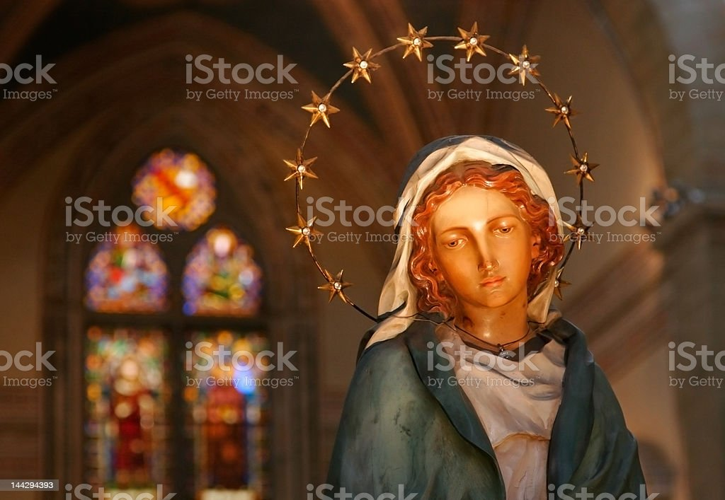 Wooden statue of Mary in church stock photo