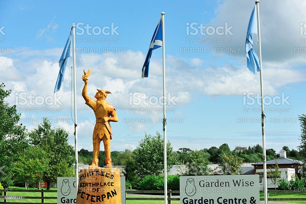 Wooden statue of Peter Pan in Dumfries Scotland stock photo