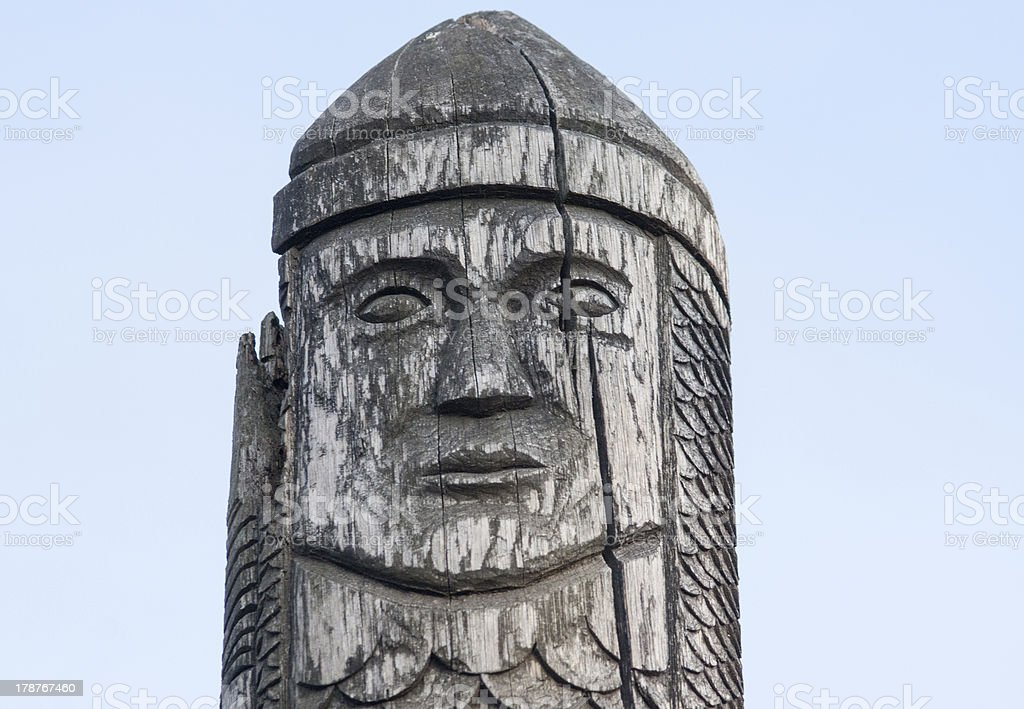 wooden statue of the ancient pagan god stock photo
