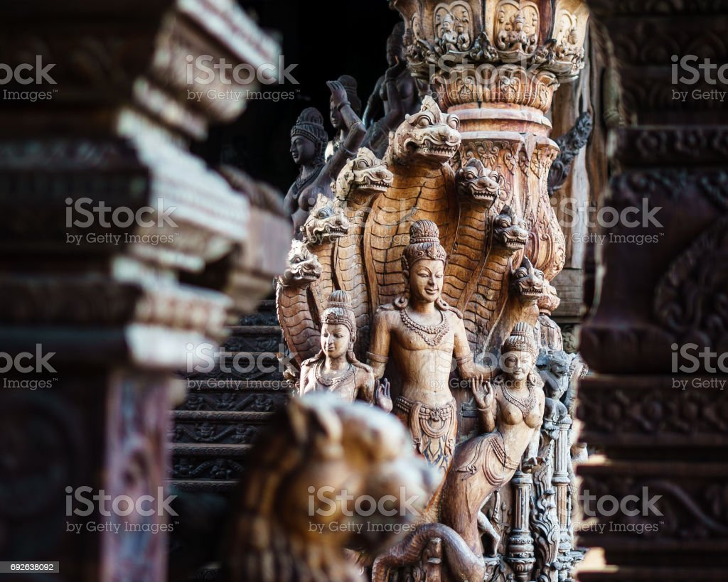 Wooden Statue of the Buddha under the Seven Headed Naga stock photo