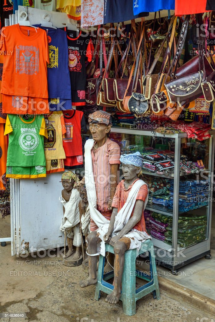 Wooden statues of Tau Tau in the market stock photo