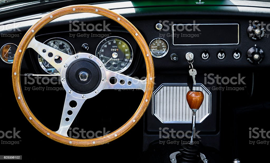 Wooden steering wheel and interior of a classic car. stock photo