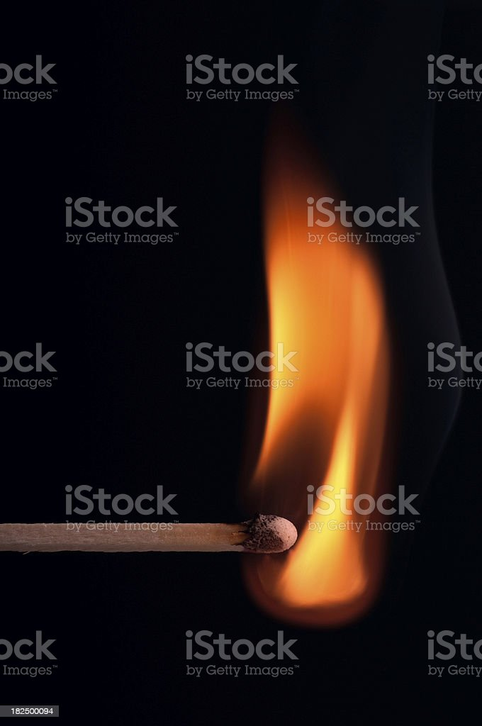 Wooden Stick Match Lit and Burning Isolated on Black royalty-free stock photo