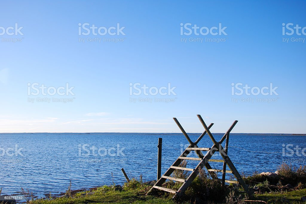 Wooden stile by the coast stock photo