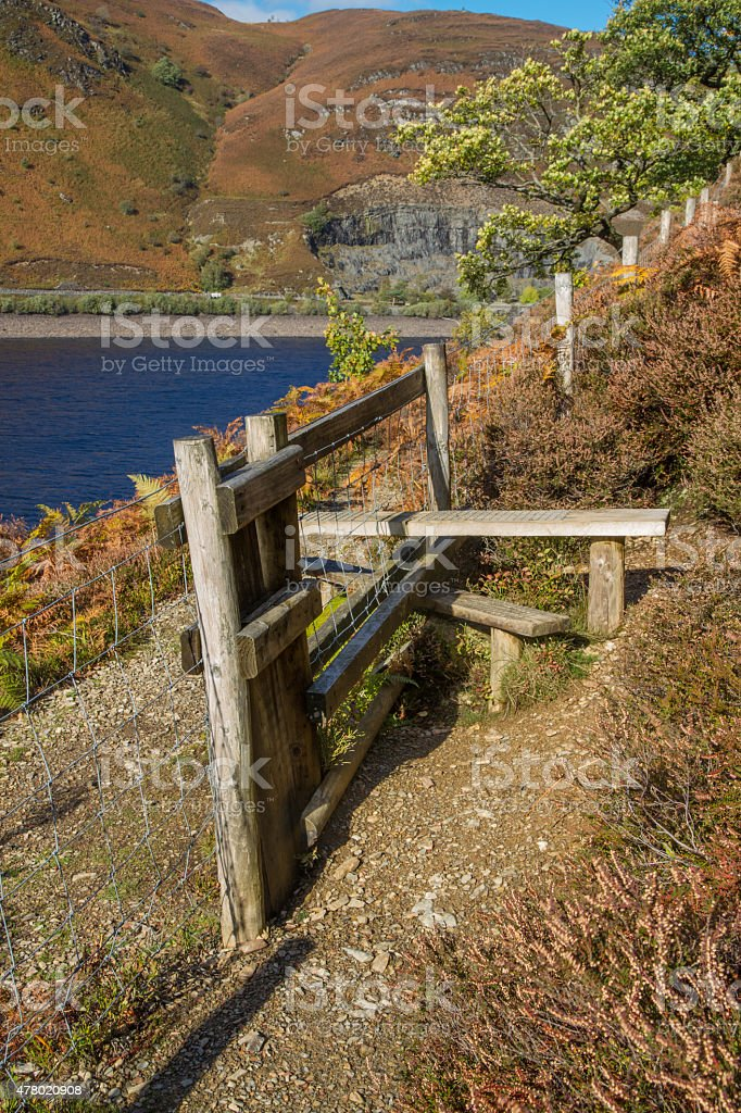 Wooden  Stile Style, over fence, with bracken. Lake and mountain stock photo