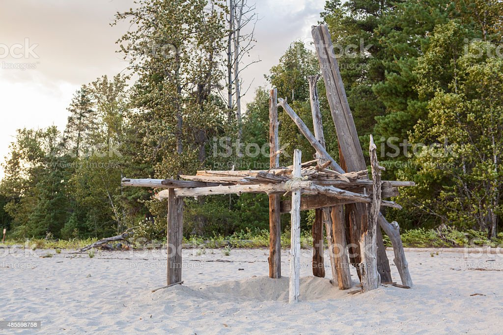 Wooden structure on the beach made from driftwood stock photo