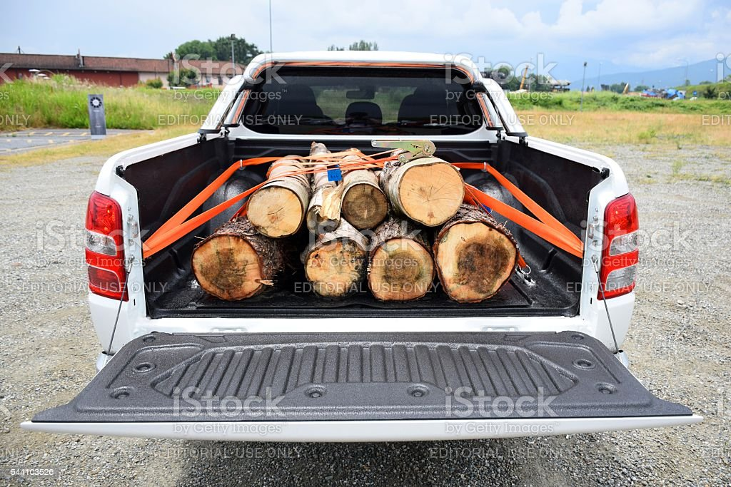Wooden stumps on the pick-up truck stock photo