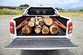 Wooden stumps on the pick-up truck