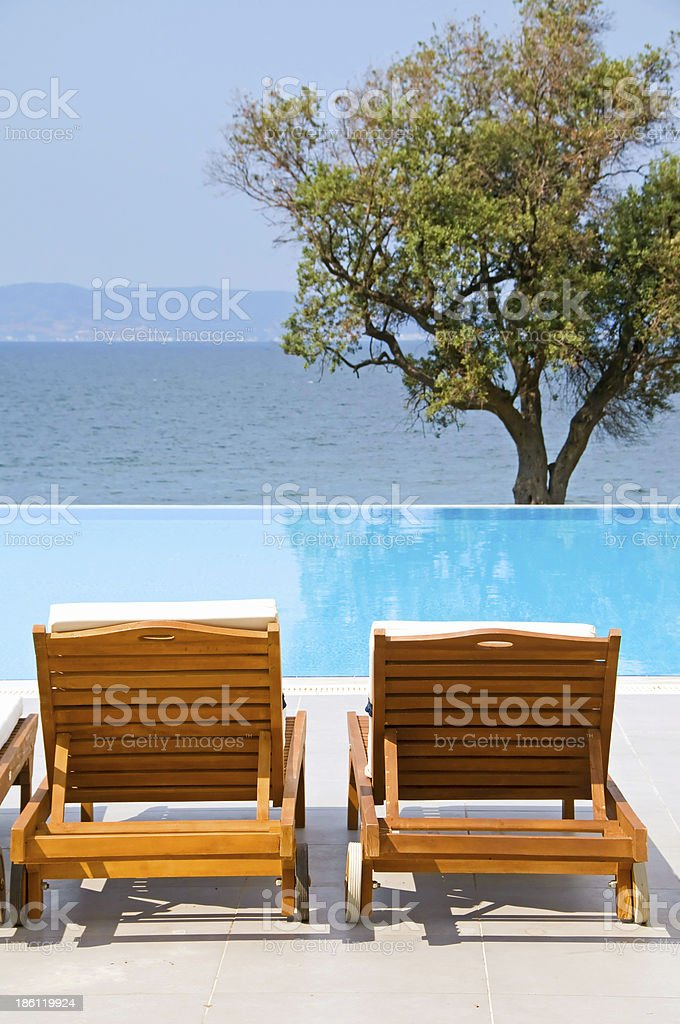 Wooden sunbeds royalty-free stock photo