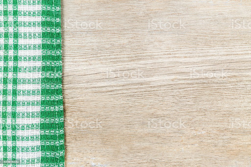 Wooden surface with a checkered cloth. stock photo