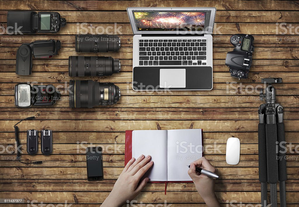 Wooden Surface with Laptop and Photography Equipment stock photo