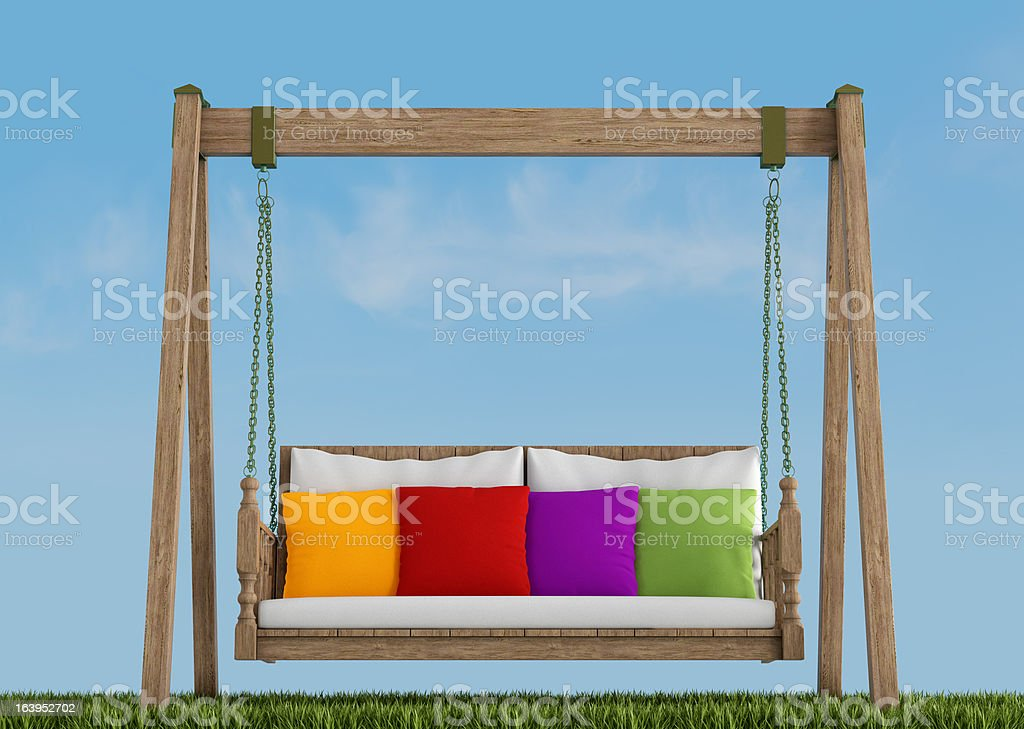 Wooden swing on grass royalty-free stock photo