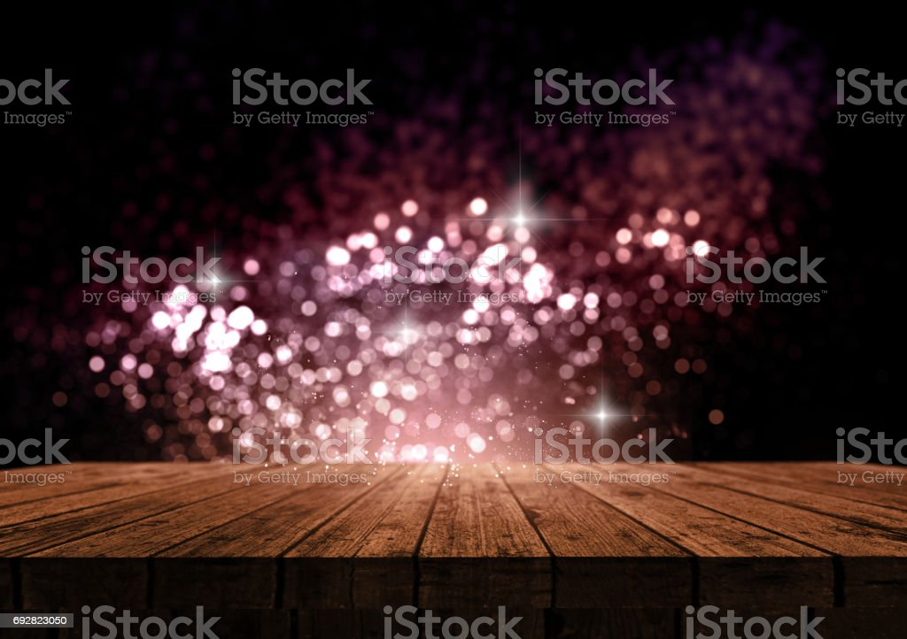 3D wooden table against a sparkle bokeh lights background stock photo