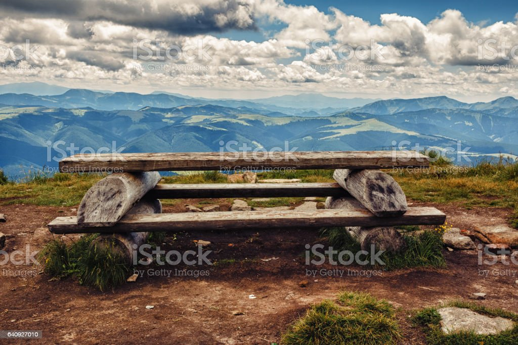 Wooden table and bench for relaxation on the top of Pip Ivan mountain, nature landscape in Carpathians, Ukraine. stock photo