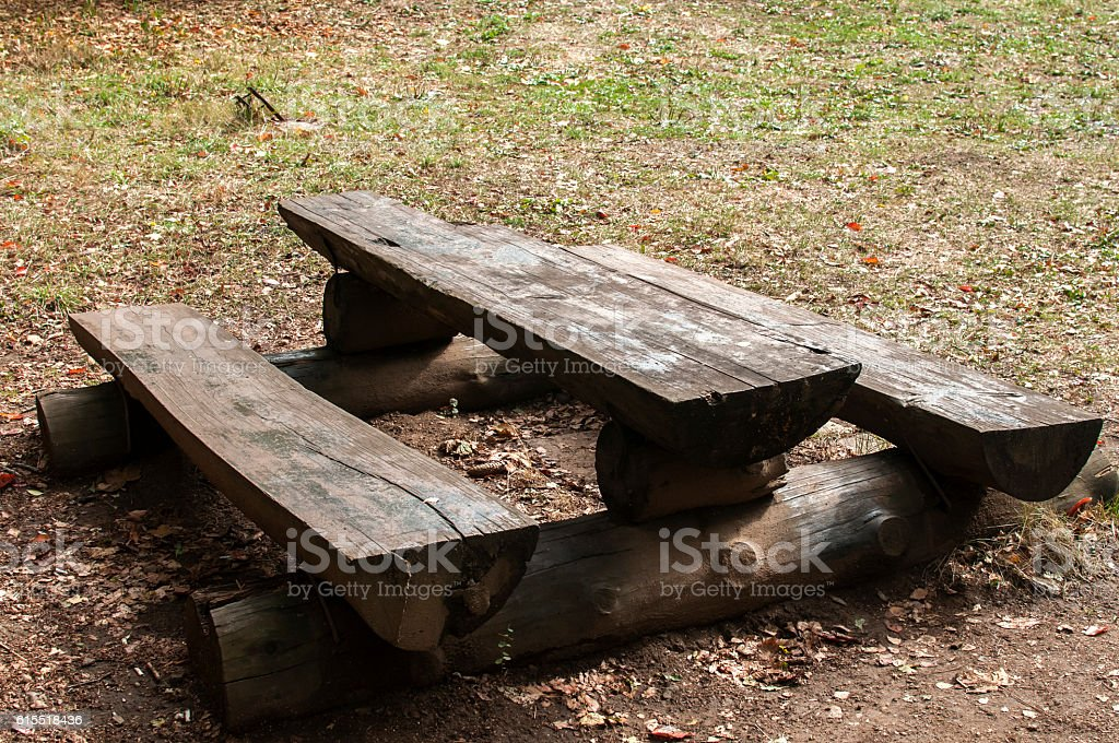 Wooden table and bench stock photo