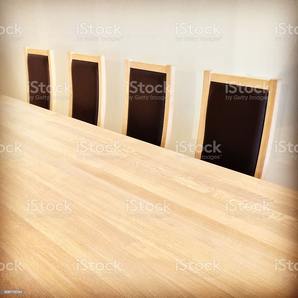 Wooden table and black chairs stock photo