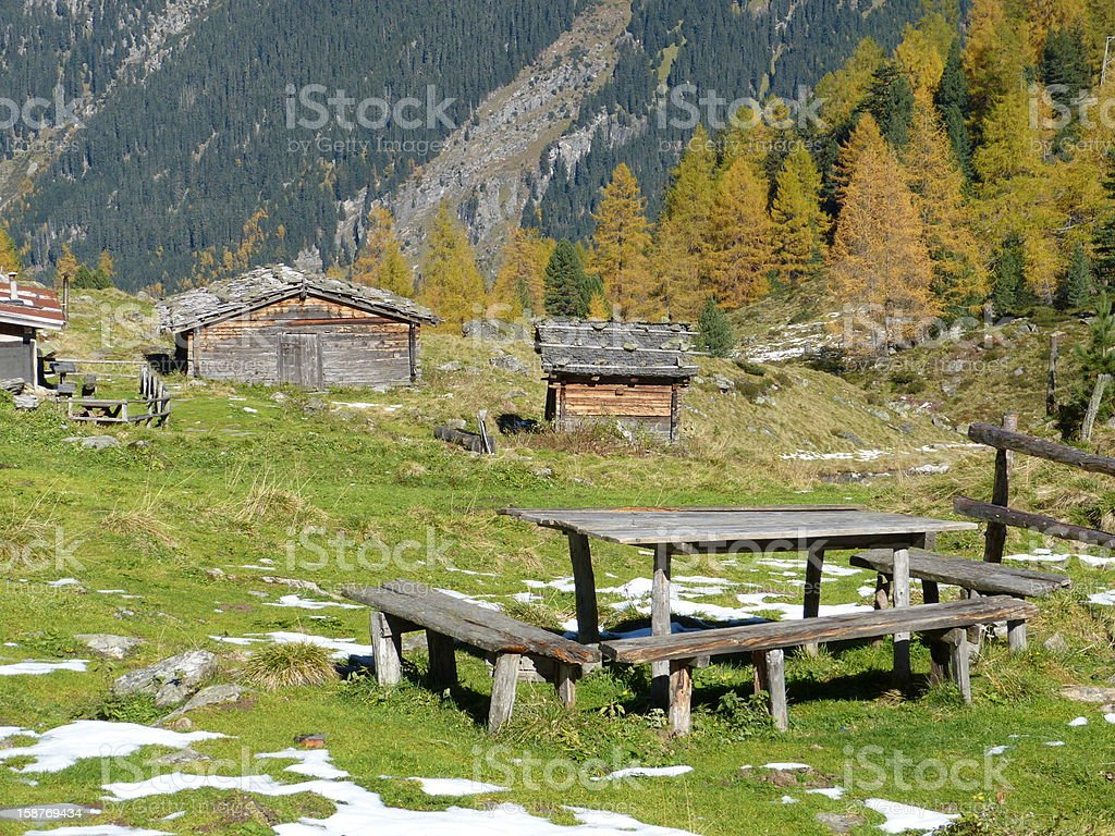 Wooden table and cottages in autumn royalty-free stock photo