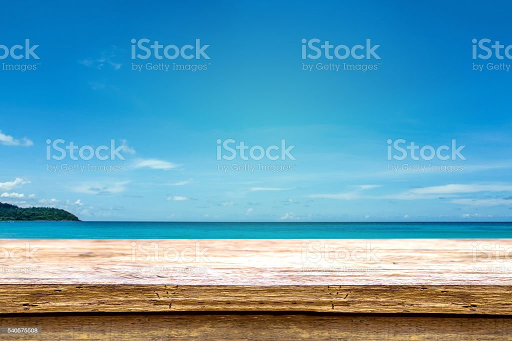 wooden table beside summer beach. stock photo