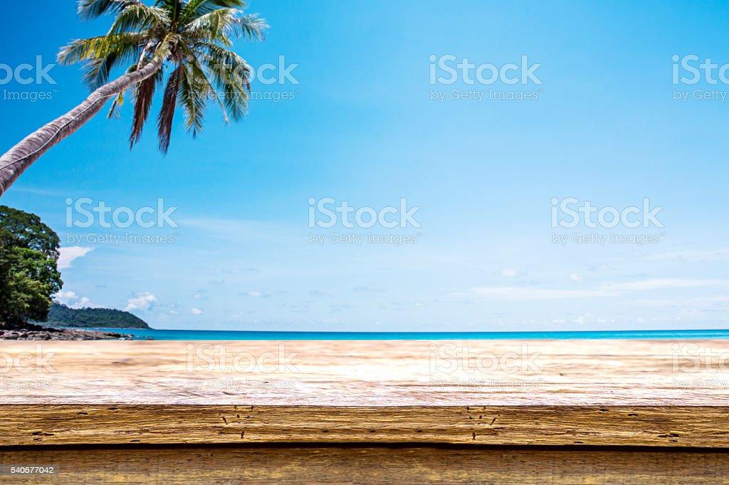 wooden table beside summer beach stock photo