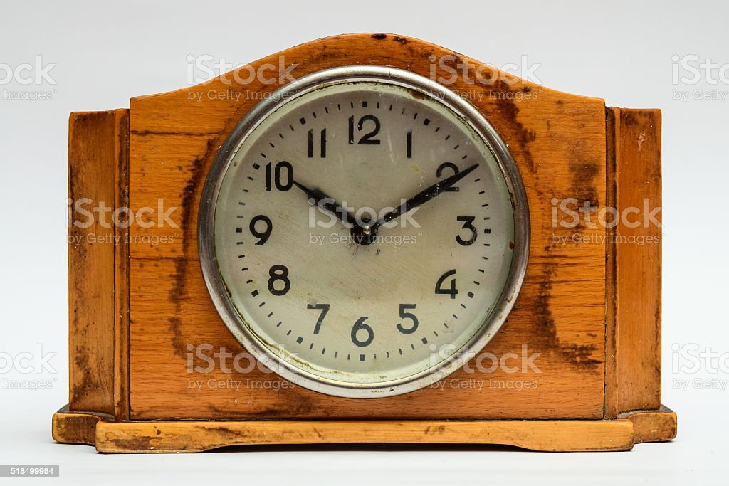 Wooden table clock on a white background stock photo