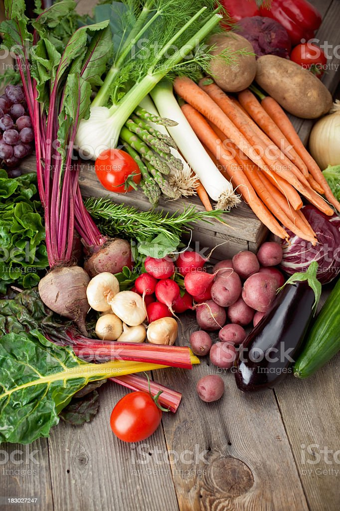 Wooden table filled with all kinds of organic produce stock photo