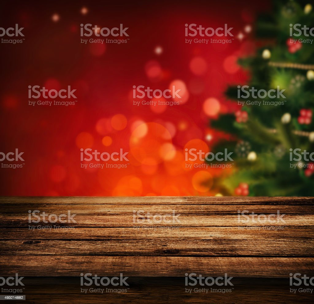 Christmas holiday background with empty wooden deck table over...