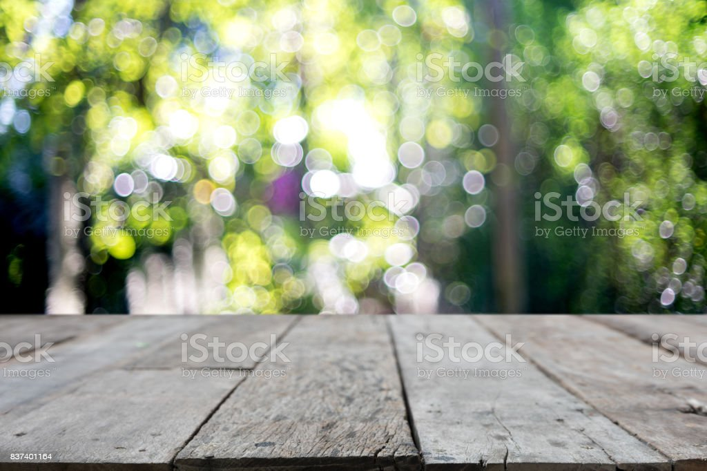 wooden table in front of the blur background with bokeh stock photo